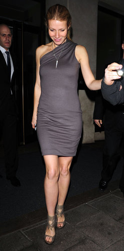 Gwyneth showcased yet another minimalist look: a slate one-shoulder dress and cutout Camilla Skovgaard sandals while leaving the Mayfair Hotel in London.