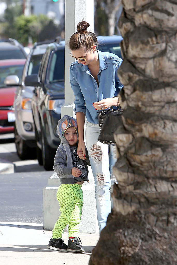 Protecting a shy Flynn from the paparazzi in Hollywood on April 8.