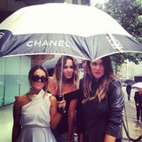 Pip Edwards and her pals hovered under a v. cool umbrella as rain hit day 2 of fashion week. Source: Instagram user pip_edwards1