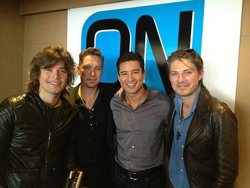 The Hanson boys stopped by On With Mario for an interview (and group shot) with Mario Lopez. Source: Twitter user MarioLopezExtra