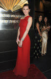 Hilary Rhoda stunned in a one-shoulder red Valentino gown, keeping the rest simple by way of statement diamond jewels and a low bun.