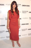 Jordana Brewster also stuck with solids in a burnt-orange midi-length dress and neutral add-ons.