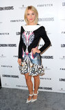 Julianne Hough's Aldo Rise x Preen white pumps proved an on-trend finish to her colorful Peter Pilotto dress.