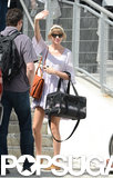 Taylor Swift held her cat, Meredith, in a carrier.