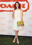 Paz Vega contrasted her white halter-style dress with a citron-hued bag by Coach.
