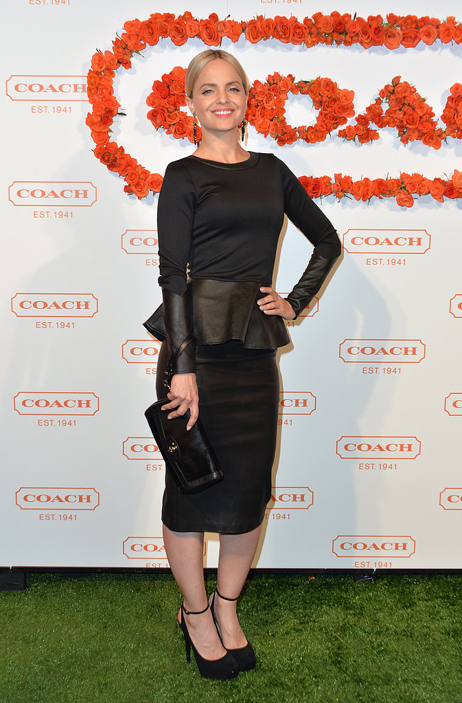 Mena Suvari went with something a little darker, but kept the mood light with the help of her dress's ruffled peplum detail and sexy ankle-strap pumps.