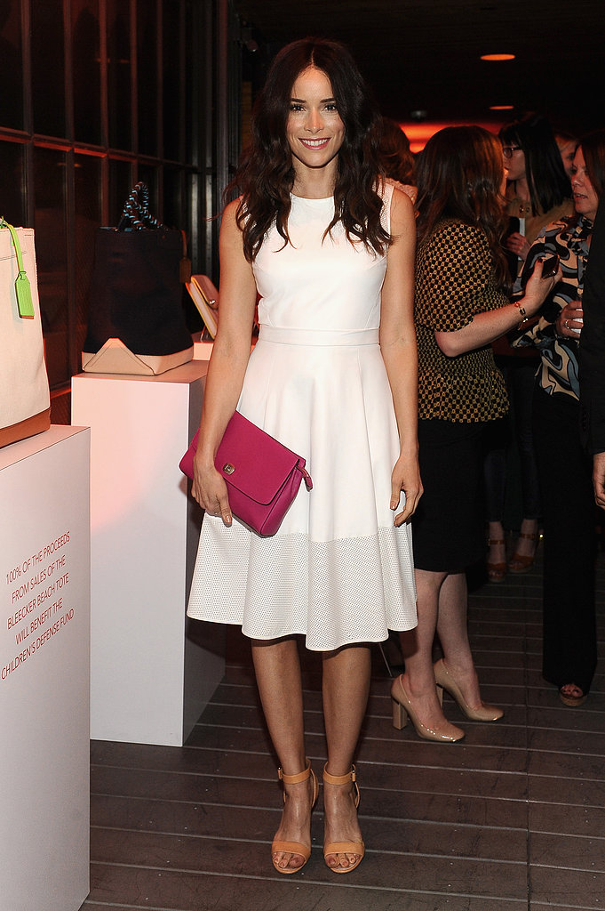 The white fit-and-flare dress Abigail Spencer wore to a Coach event in Santa Monica is perfect for the bride-to-be. Add a pink bag, like Spencer did with her Coach clutch, and nude ankle-strap sandals for a minimalist finish.