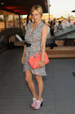 Chloë Sevigny looked ultrafeminine in a printed Balenciaga dress and a coral-hued Coach Legacy basket clutch.