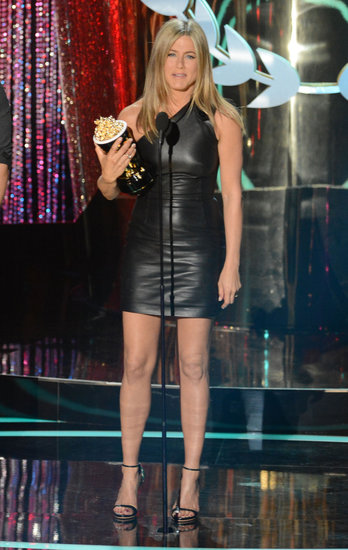 Jennifer Aniston showed off her badass onstage style in a slick leather Valentino minidress and Giuseppe Zanotti sandals at the 2012 show.