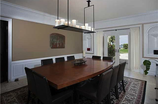 The traditional dining room is contrasted with contemporary pieces that could easily accompany large dinner parties.  Source: Coldwell Banker Real Estate