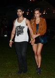 Joe Jonas held hands with his lady friend.