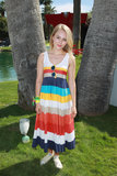 AnnaSophia Robb's striped Lacoste maxi and Converse sneakers made a playful pairing at the Lacoste party.
