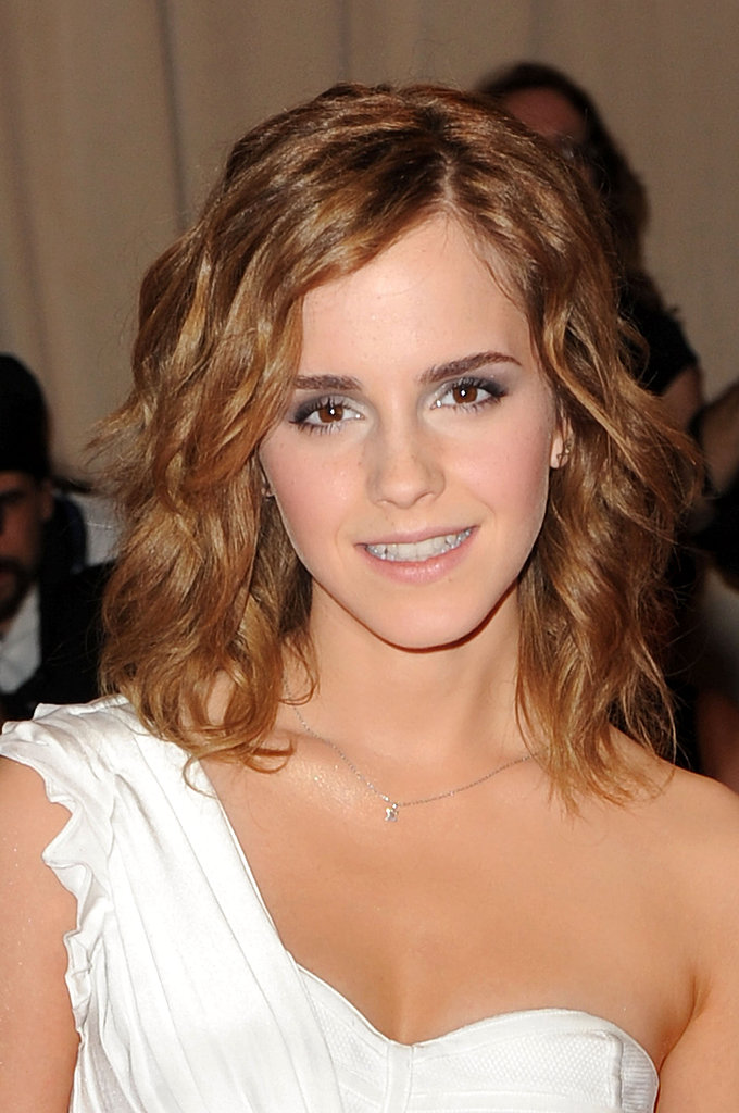 Tousled waves and gray eye shadow was the look for Emma at the 2010 Met Gala.