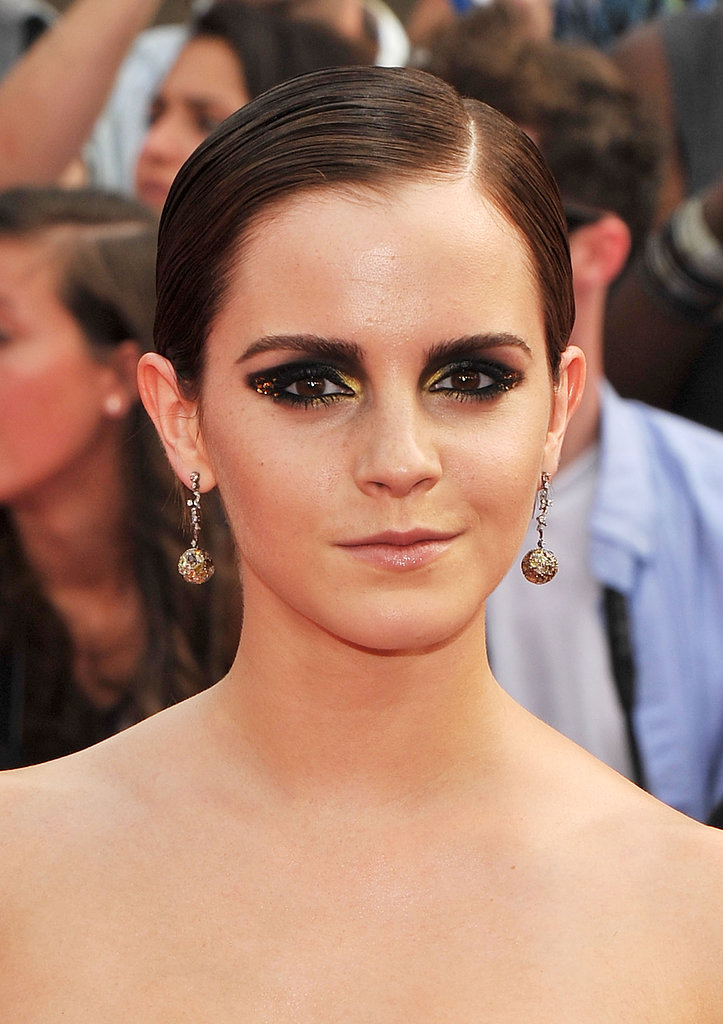 At the New York premiere of Harry Potter and the Deathly Hallows: Part 2, Emma paired a slicked-back hairstyle with a dramatic smoky eye. Flecks of gold were nestled in the outer corners of her eyes while gilded shadow lined the inner corners for a spellbinding look.