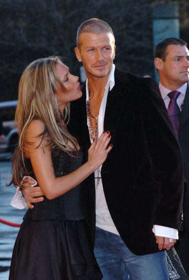 David Beckham stayed close to Victoria at a London party in April 2004.