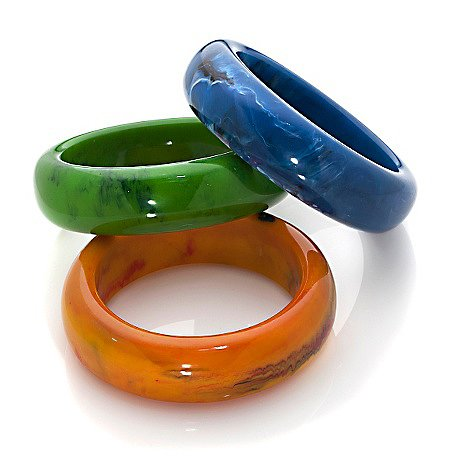 Iris Apfel Three-Piece Bracelet Set Oh, what fun it is to accessorize with these green, blue, and orange-yellow bangles for a blast of colorful whimsy.