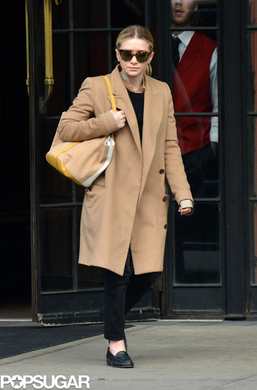 Ashley Olsen wore a long beige coat to a meeting in NYC on Monday.