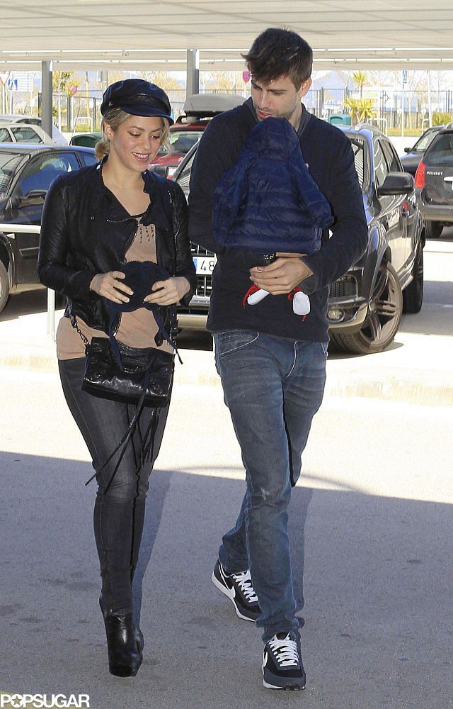 Gerard Piqué and Shakira made their way to the Barcelona airport with their son, Milan.