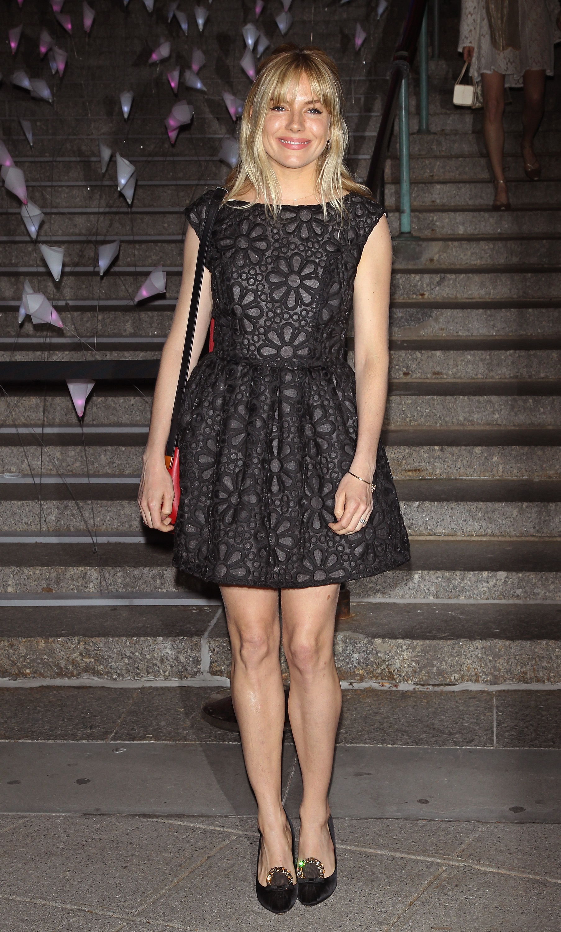 Sienna Miller wore a black dress to Vanity Fa