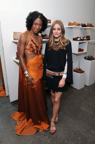 Olivia styled a black skirt and top with eclectic, global-feeling accessories, like layers of colored necklaces, an embroidered belt and a pair of beaded sandals for an appearance at the Pikolinos pop-up store opening celebrating the Maasai Project.
