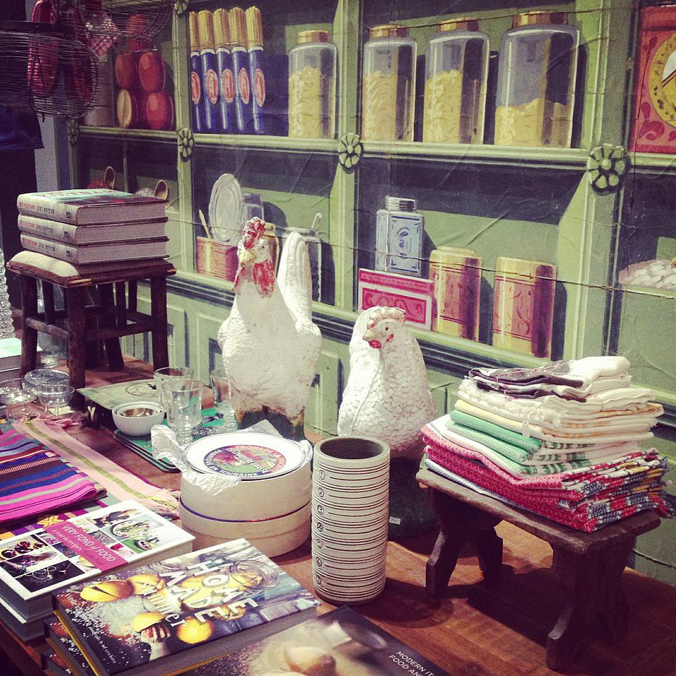 We're obsessing over the wallpaper (and those roosters) at Nest. The tea towels and cookbooks would make great house-warming gifts.