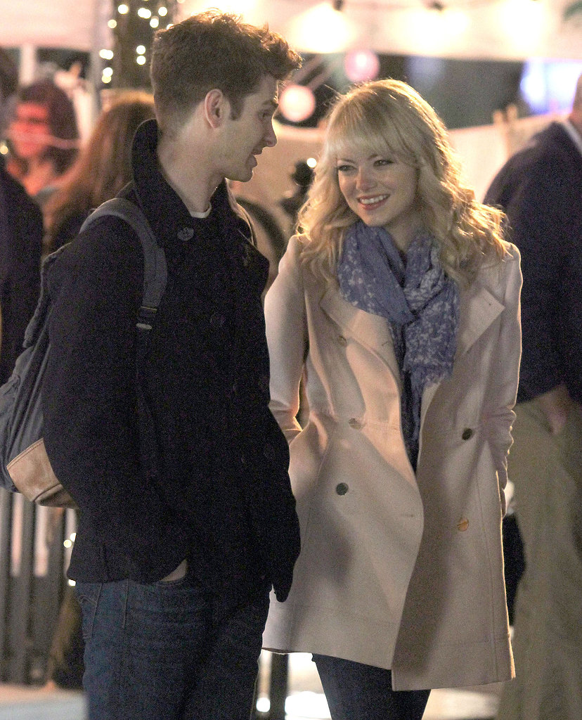 Andrew Garfield and Emma Stone got cozy on Monday while filming scenes for The Amazing Spider-Man 2 in NYC.