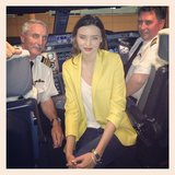 Miranda Kerr sported a bright yellow blazer and posed with pilots on her Qantas Airways flight to Australia. Source: Instagram user mirandakerr