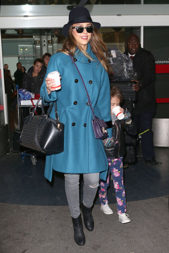 Jessica oozed California-cool in gray J Brand jeans, a blue wool Sportmax coat, and Rag & Bone ankle boots. She topped her travel style with a black wide-brim hat, a purple Jimmy Choo crossbody bag, and matte shades.