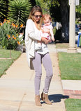 The colored-jean queen wore light-purple Genetic Denim skinny jeans with a white tee and a slouchy shawl cardigan while taking Haven for a walk in LA. For accessories, the actress sported printed sunglasses and taupe wedge booties.
