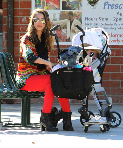 While enjoying a LA park playdate with her daughters, Alba styled a vibrant striped Amanda Uprichard top with fiery Kate Spade jeans.