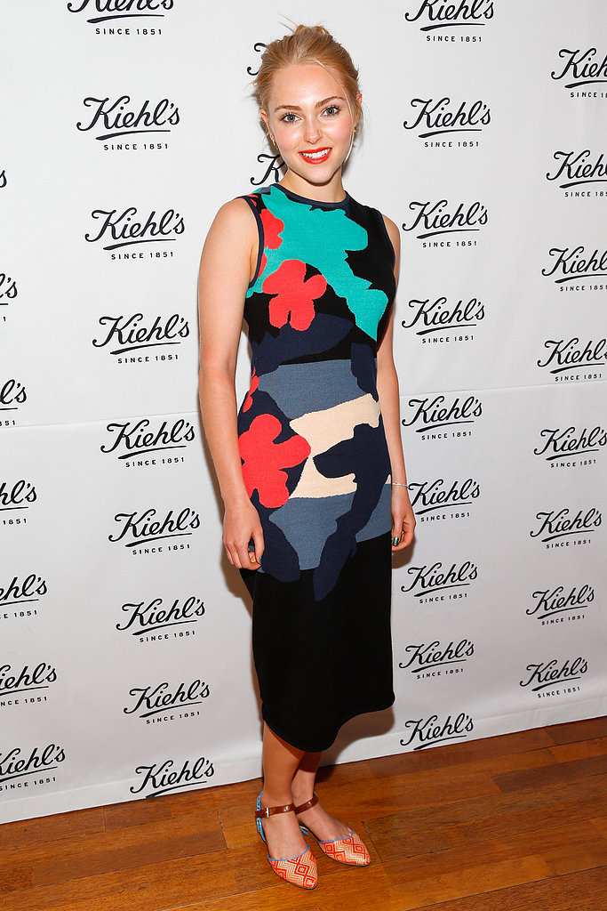 At a Kiehl's event in Santa Monica, AnnaSophia Robb donned a multi-colored midi dress with dual-print Aldo ankle-strap flats.