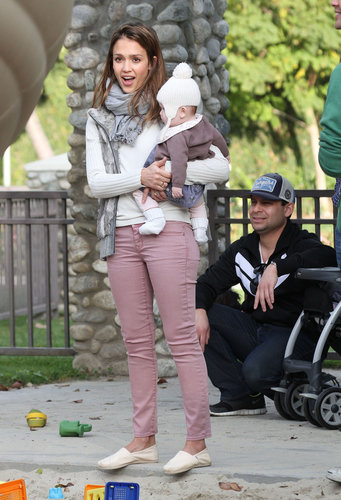 Jessica Alba unveiled the perfect transitional ensemble in rose-hued Gap denim, a gray fur vest, and cream TOMS while enjoying some family time at a Beverly Hills park.
