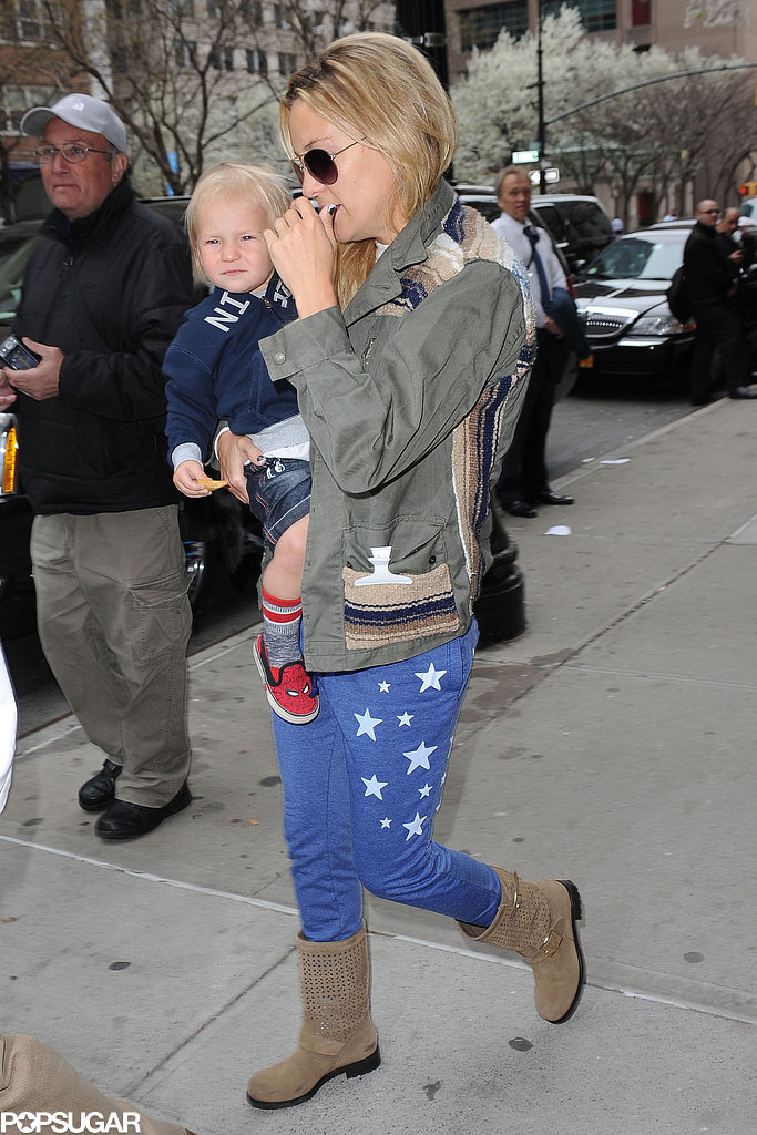 Kate Hudson carried her son Bingham Bellamy for an outing in NYC.