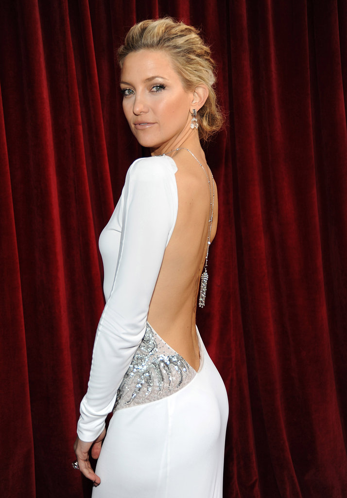 Kate donned a sexy backless dress at the Screen Actors Guild Awards in 2010. She complemented her skin-baring number with a mussy updo and shimmering gold makeup.