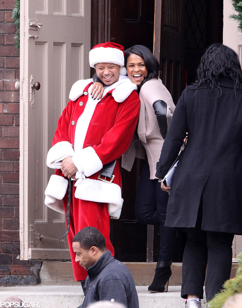 Terrence Howard dressed as Santa Claus and laughed with Nia Long on the Vancouver set of The Best Man Holiday on Thursday.
