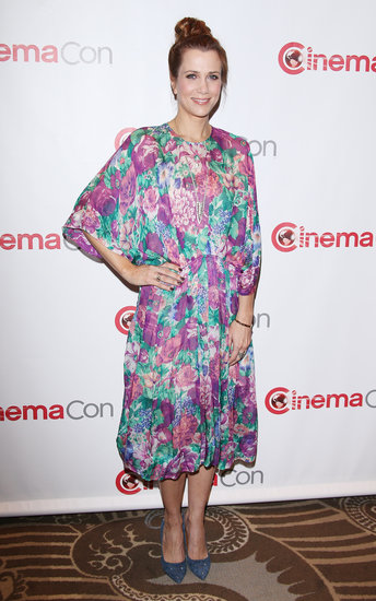 Kirsten Wiig took a more feminine approach in a floral midi-length dress and blue studded pumps.