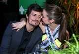Miranda planted a sneaky kiss on Orlando at Global Green USA's 10th Annual Pre-Oscar Party in Feb 2013.