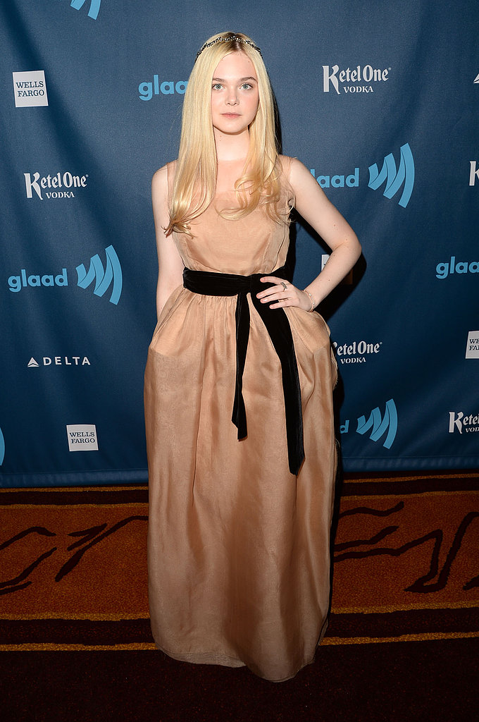 Elle Fanning looked perfectly sweet in a Lanvin peachy-hued voluminous gown, finished with a black ribbon belt at the waist and rhinestone headpiece.