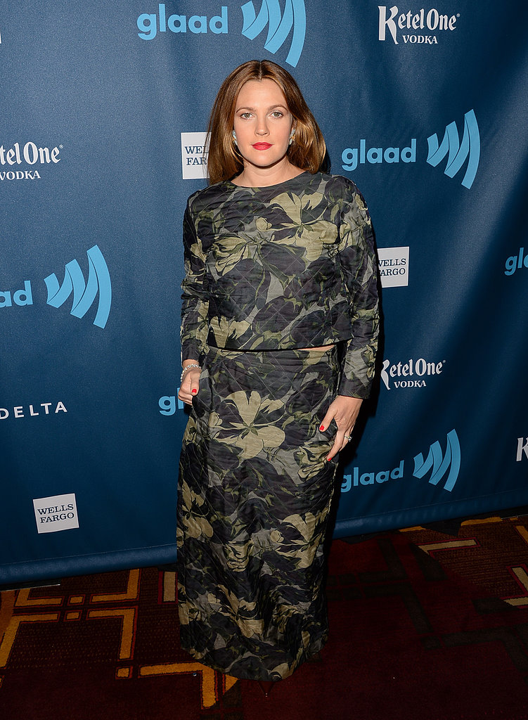 Drew Barrymore opted for a two-piece Dries van Noten top-and-skirt set covered in an all-over floral print. She offset the darker hues of her ensemble with a bright red lip.