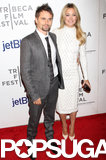 Kate Hudson got dressed up in a white Jenny Packham dress to attend the Tribeca Film Festival premiere of The Reluctant Fundamentalist with fiancé Matthew Bellamy by her side.