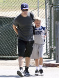 Ryan Phillippe put on a baseball cap and watched his son Deacon's football game in LA on Saturday.