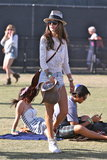 Alessandra Ambrosio roamed the Coachella grounds in a white crochet top, denim cutoffs with lace detailing, studded cowboy boots, a brown fringe crossbody bag, finished with cat-eye sunglasses and a fedora.