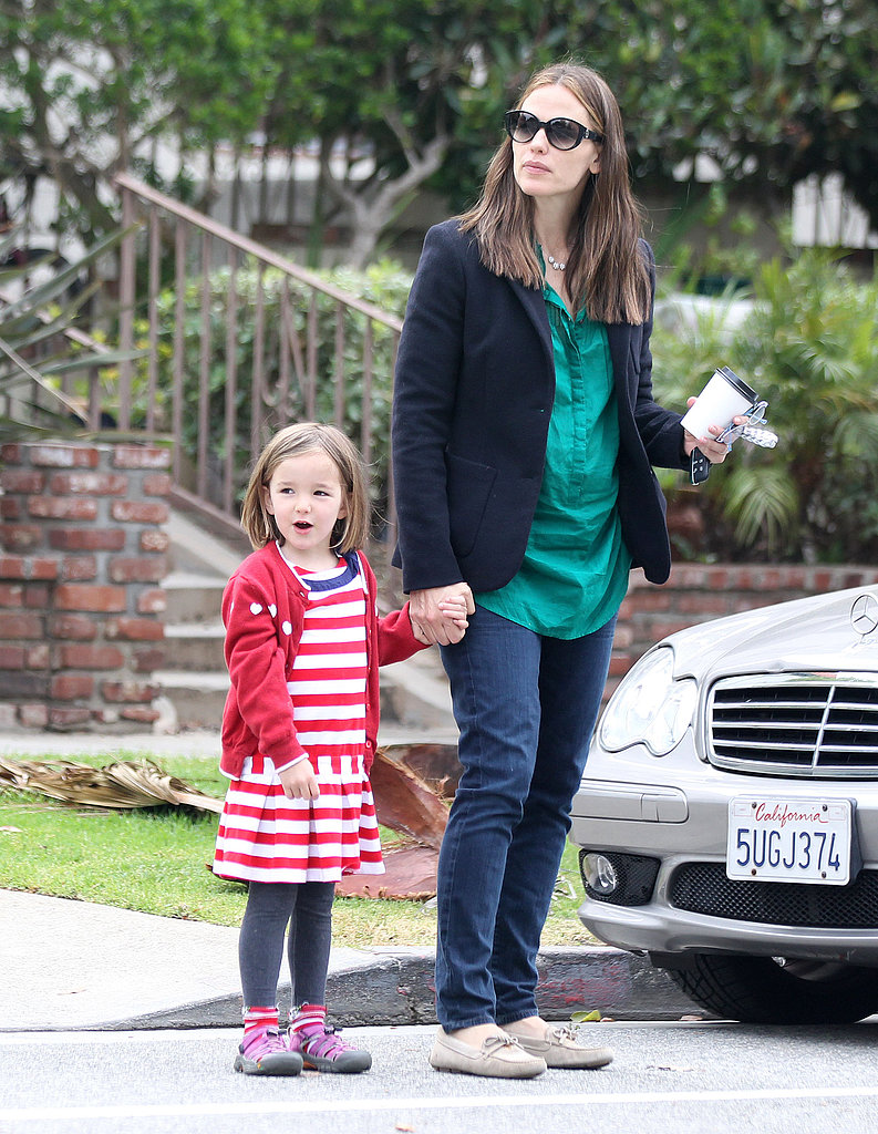 Jennifer Garner held a coffee in one hand and her daughter Seraphina's hand in the other.