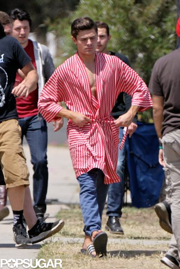 Zac Efron tightened his robe while on the set of Townies on Tuesday.