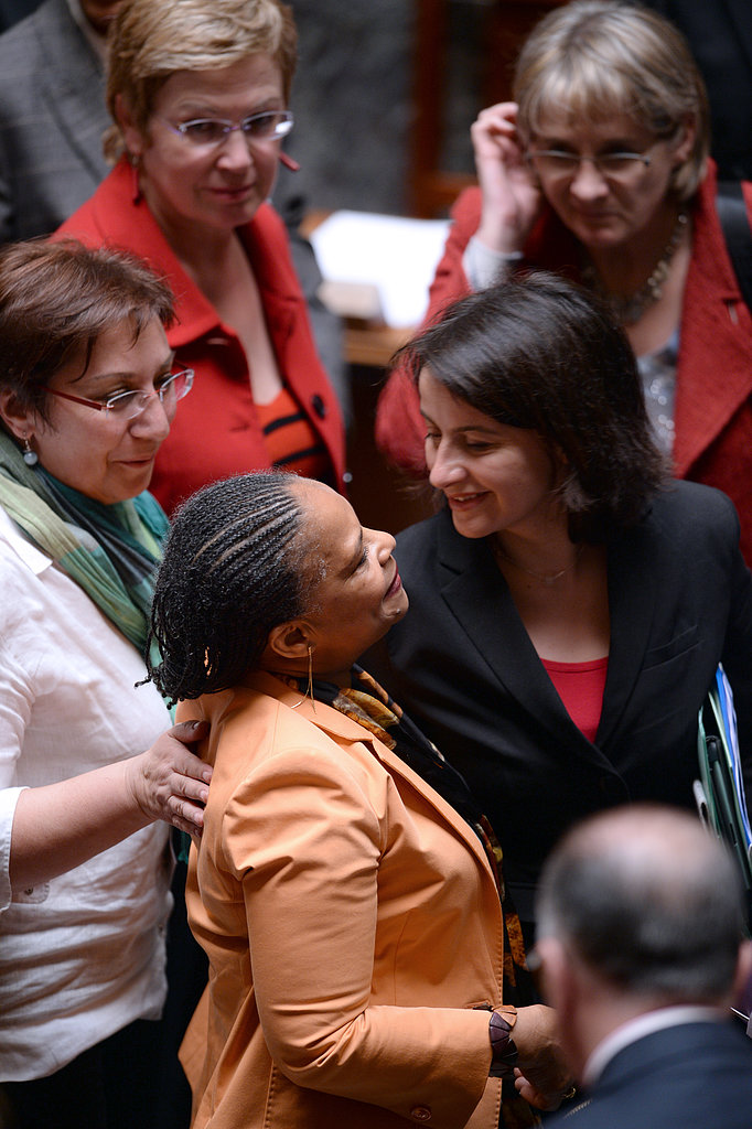 French Justice Minister Christiane Taubira was congratulated by Housing Minister Cécile Duflot after the vote of the same-sex-marriage bill.