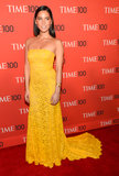 Olivia Munn dazzled in a marigold yellow dress on the red carpet.