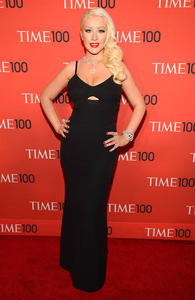 Christina Aguilera showed off her curves in a formfitting Victoria Beckham Spring '13 gown. She accessorized with bold jewels, then added a red lip and sideswept waves.