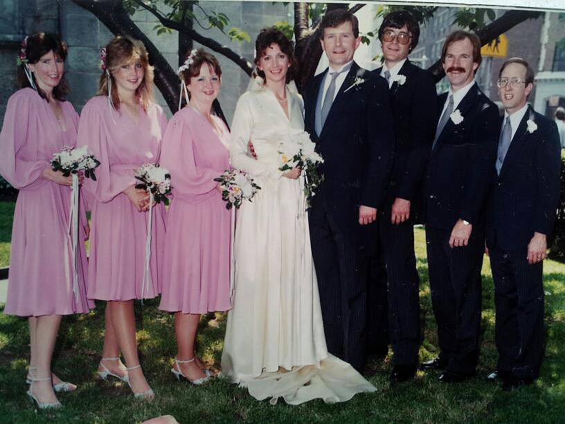 The matching pink bridesmaids dresses in this 1983 wedding were short and sweet.