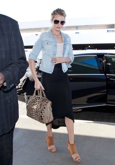 Rosie Huntington-Whiteley gave her cutout heels and draped maxi skirt a dressed-down finish with a staple denim jacket.