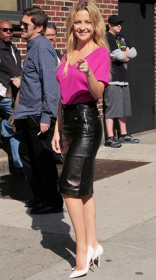 Kate Hudson tucked a bright pink tee into a black leather pencil skirt accessorized with crisp white Christian Louboutin pumps while visiting The Late Show in NYC.